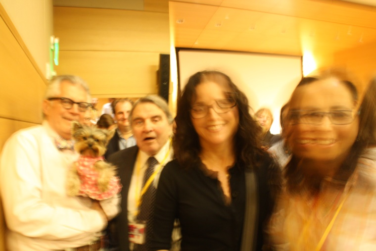 Is this an out-of-focus pic of Meteorologist Ron, Schmitty The Weather Dog with William & Julia Louis-Dreyfus and Julie Synder or is it art? Arf-Arf!