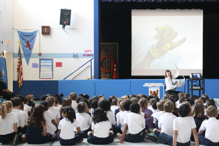 Reading her Schmitty The Weather Dog: Daydream book,  Author Elly brings literacy & fun to students at the Lyles_Crouch School in Virginia.