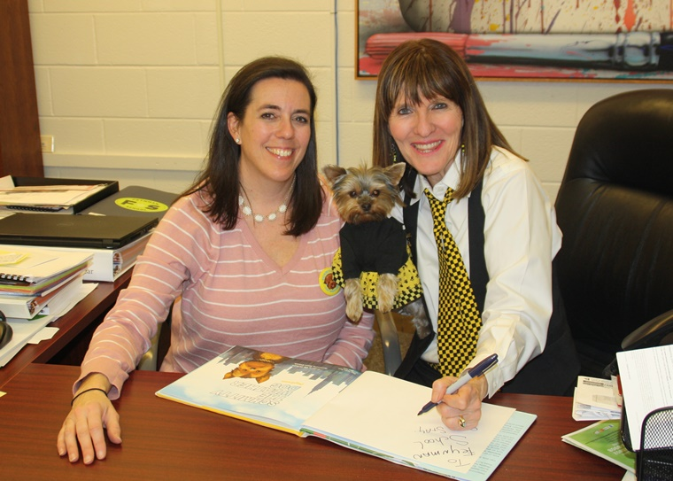 With Principal Susan paw-tographing one of my Schmitty The Weather Dog books for the Feynman School for Gifted Students library in Bethesda, MD. I love my job!