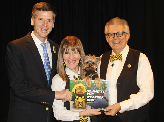 Head Master Gregory O'Melia of the Buckley School in Manhattan poses with Team Schmitty The Weather Dog after their STEM Assembly.