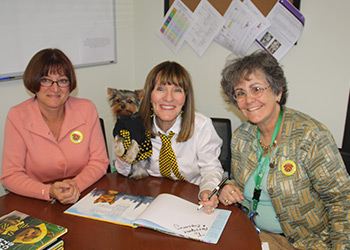 Schmitty The Weather Dog paw-to-graphs books for Principal Gayle Hills & STEM Coach Dr Jan Mooney-Frank